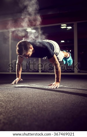 Handsome athlete working extreme push ups. Shallow depth of field. - stock photo
