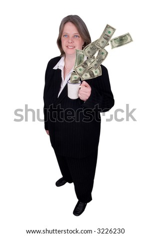 Handsome attractive businesswoman in suit with a cup of coffee in hand filled with money with a happy expression on white background - stock photo