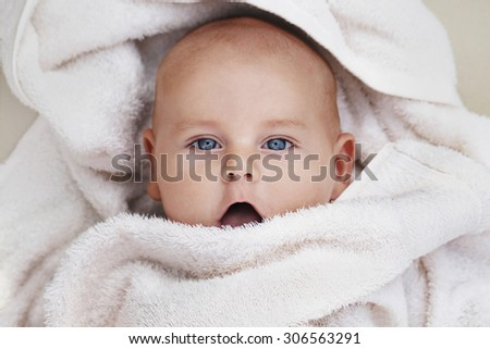 handsome baby boy in the white towel - stock photo