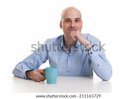 handsome bald man drinking a cup of coffee or tea isolated white background - stock photo