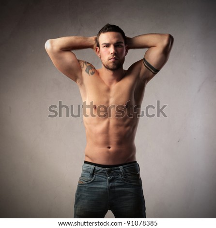 Handsome bare-chested brawny man - stock photo