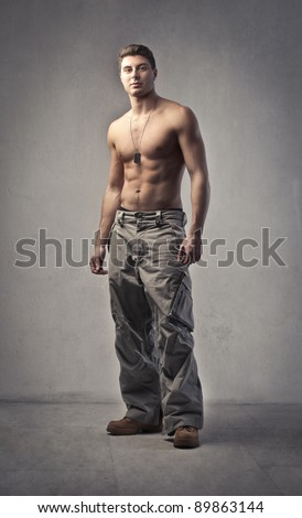 Handsome bare-chested young man - stock photo