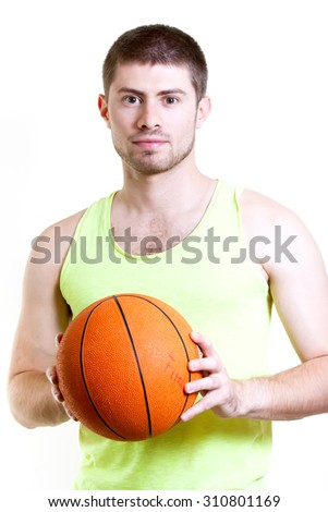 Handsome basketball player holding ball on white background