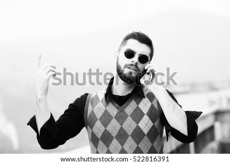 handsome bearded young man talking on a mobile phone