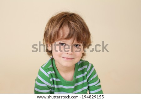 Handsome, beautiful caucasian smiling child, fashion and clothing concept