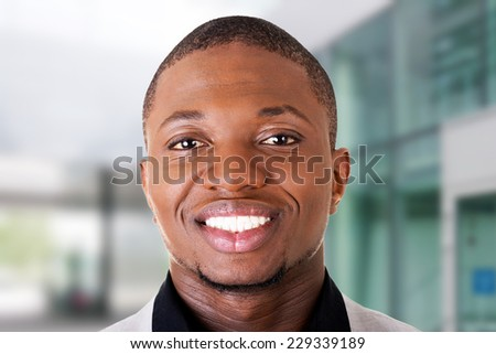 Handsome black male businessman smiling toothy - stock photo