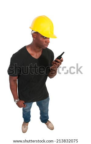 Handsome black man construction worker talking on a walkie talkie - stock photo