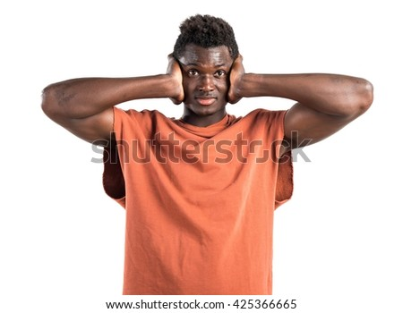 Handsome black man covering his ears - stock photo