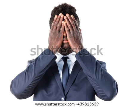 Handsome black man covering his face - stock photo