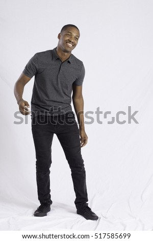 Handsome Black man dancing for joy