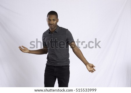 Handsome Black man in a gray shirt, dancing for joy