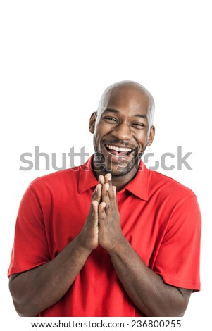 Handsome black man in his 20s laughing isolated on a white background - stock photo