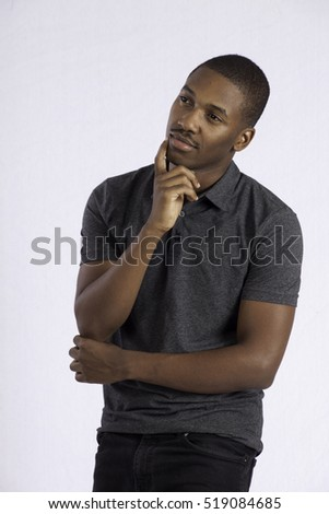 Handsome Black man looking thoughtful