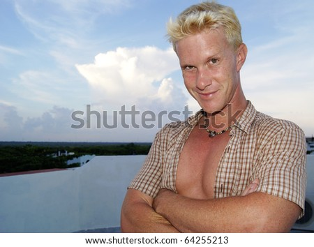 Handsome blond man by the beach