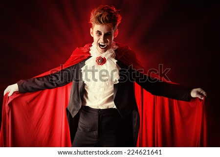 Handsome bloodthirsty vampire. Halloween. Dracula costume. - stock photo