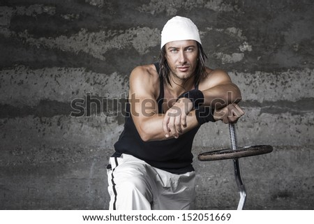 Handsome blue eyes athletic man posing in front of the camera