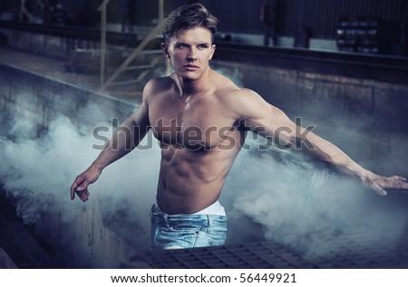 Handsome bodybuilder wearing jeans - stock photo