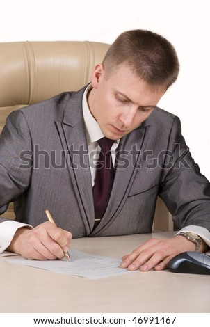 handsome boss sitting at the desk with blank paper and pen in hand