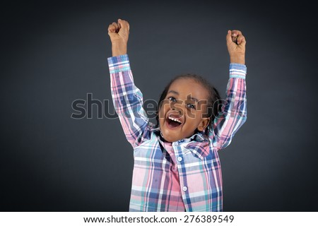 Handsome boy doing different expressions in different sets of clothes: arms raised - stock photo