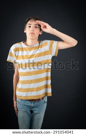 Handsome boy doing different expressions in different sets of clothes: at attention - stock photo