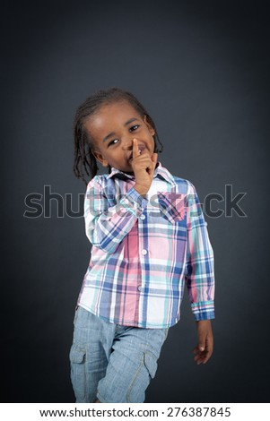 Handsome boy doing different expressions in different sets of clothes: be quiet - stock photo