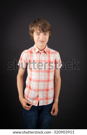 Handsome boy doing different expressions in different sets of clothes: blinking - stock photo