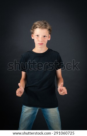 Handsome boy doing different expressions in different sets of clothes: gun sign - stock photo