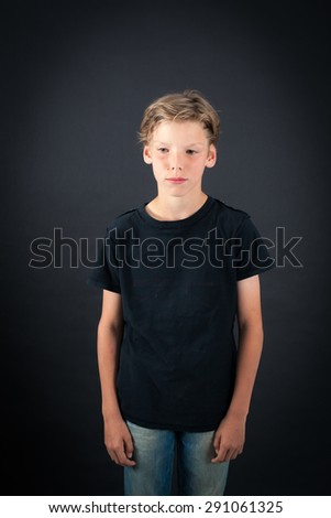 Handsome boy doing different expressions in different sets of clothes: sad - stock photo