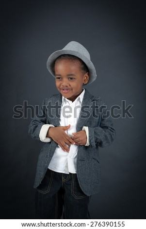 Handsome boy doing different expressions in different sets of clothes: stomachache - stock photo