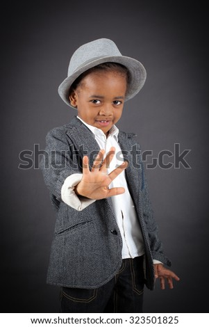 Handsome boy doing different expressions in different sets of clothes: stop sign - stock photo