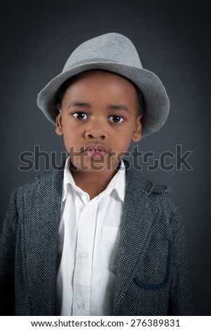 Handsome boy doing different expressions in different sets of clothes: thinking - stock photo