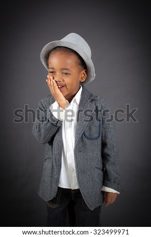 Handsome boy doing different expressions in different sets of clothes: toothache - stock photo