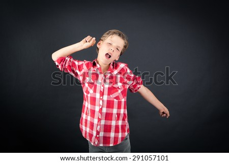 Handsome boy doing different expressions in different sets of clothes: wake up - stock photo