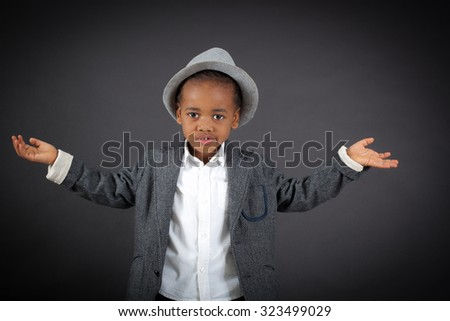 Handsome boy doing different expressions in different sets of clothes: welcome - stock photo