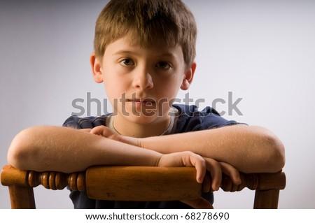 Handsome boy feeling sad - stock photo