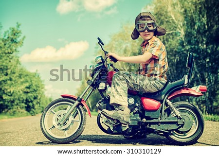 Handsome boy go on a journey on a motorcycle. Adventure. Summer holidays. Active lifestyle. - stock photo