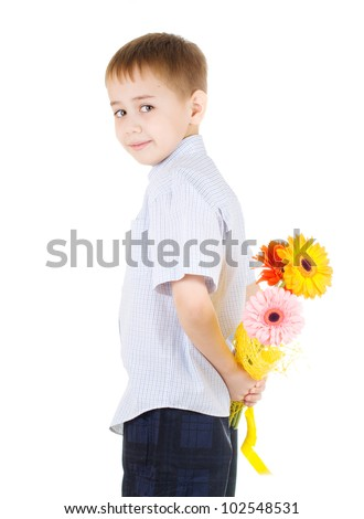 handsome boy holding a bouquet of flowers behind himself - stock photo