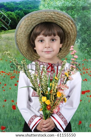 handsome boy in a straw hat with a bouquet of wildflowers