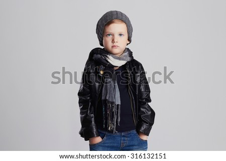 handsome boy in scarf.Funny child in hat.fashionable little boy.stylish kid in leather coat - stock photo