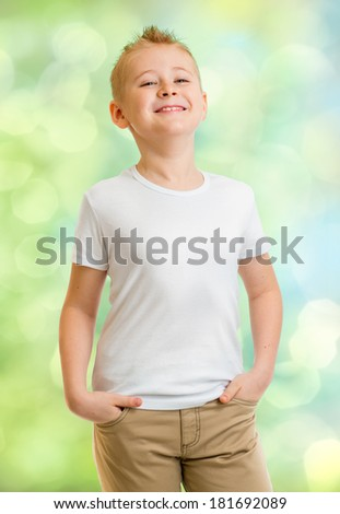 Handsome boy in white tshirt outdoor - stock photo