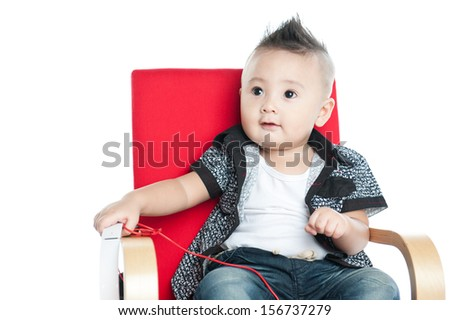 handsome boy sitting on chair against white background