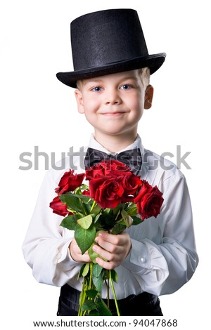 handsome boy wearing classic suit with flowers in hands isolated over white - stock photo