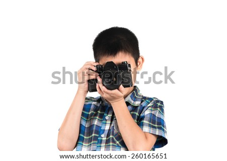 handsome boy with an old camera isolated on white. - stock photo