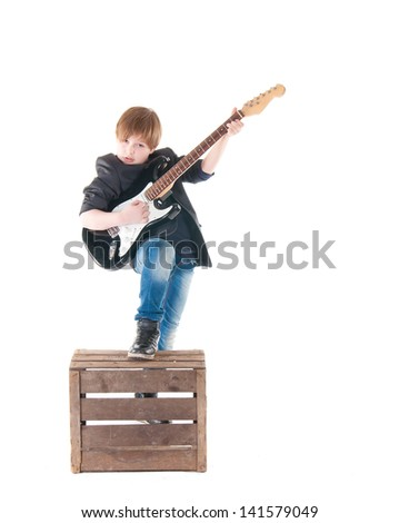 Handsome boy with electric guitar. over white background - stock photo
