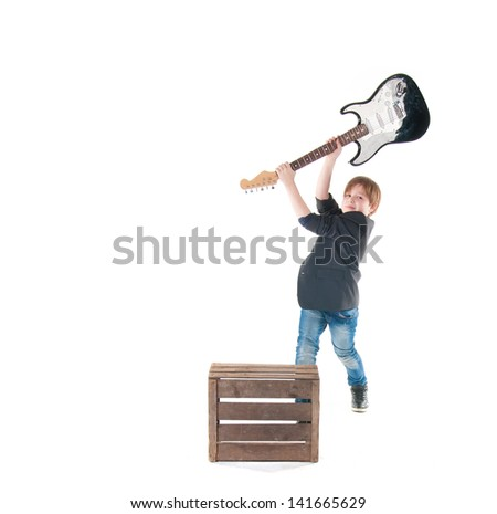 Handsome boy with electric guitar posing. - stock photo