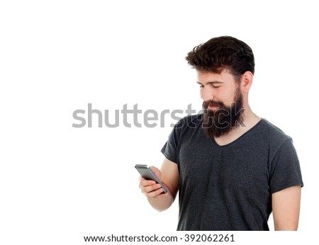 Handsome boy with long beard and a mobile isolated on white - stock photo