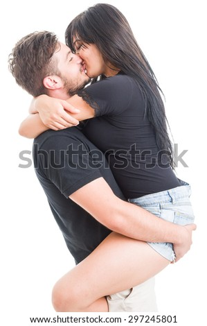 Handsome boyfriend holding and kissing happy girlfriend on white background - stock photo