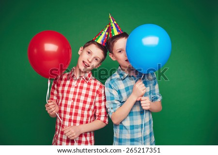Handsome boys with balloons on birthday party - stock photo
