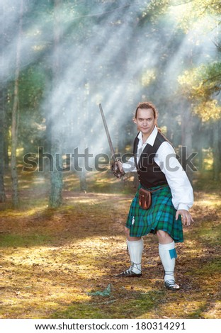 Handsome brave scottish man with sword  - stock photo