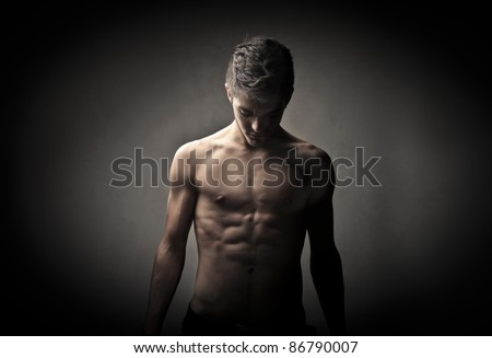 Handsome brawny bare-chested man - stock photo